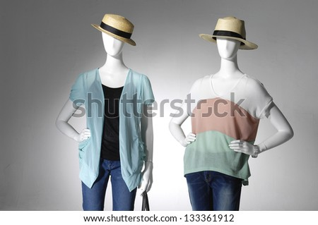 fashion female clothes in hat on two mannequin
