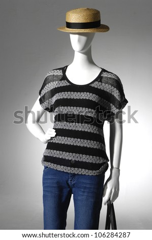 fashion female clothing in jeans with bag on mannequin