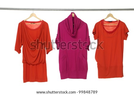 Fashion female red clothing hanging on hangers