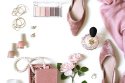 Fashion feminine blogger concept. Minimal set of woman accessories on white background. Still life of pink wedding objects: rose, cosmetics, perfume, jewellery and shoes with space for text