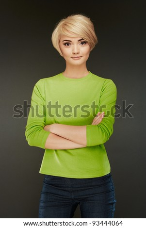 Fashion girl. Casual style. Isolated portrait. Confident woman crossed arms