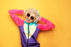Fashion girl in sportswear on yellow background