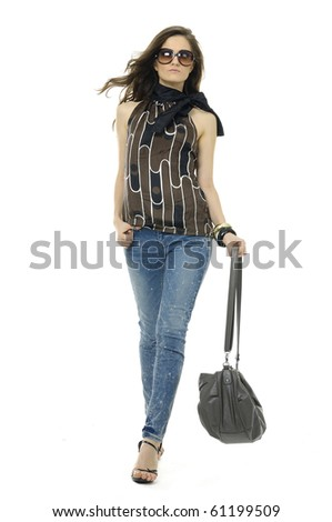 Fashion girl in sunglasses and in jeans show in studio