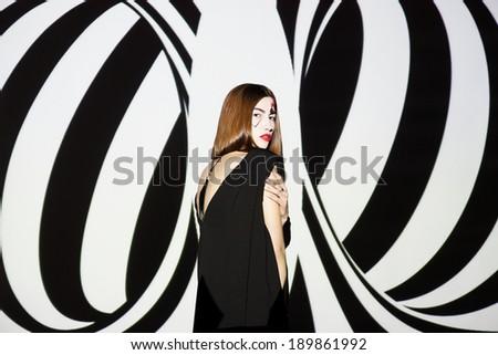 Fashion girl on black and white geometric background