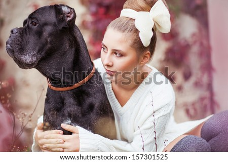 fashion girl with a dog laughing in the autumn park