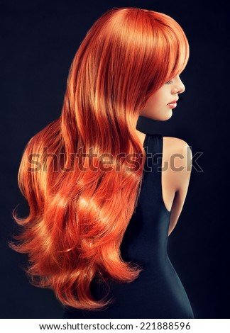 Fashion Girl with beautiful and shiny red hair