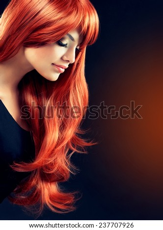 Fashion Girl with beautiful curl and shiny red hair