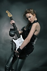 Fashion girl with guitar playing hard-rock!