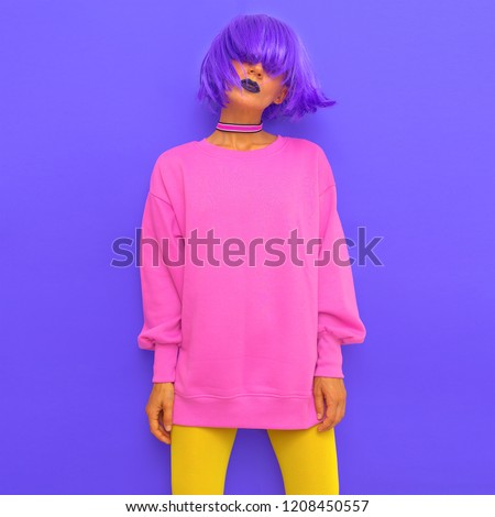 Fashion Girl with purple hair and bright stylish look. Trends make up. Colorful party vibes