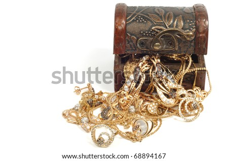 Fashion gold jewelry in wooden box, isolated on white background