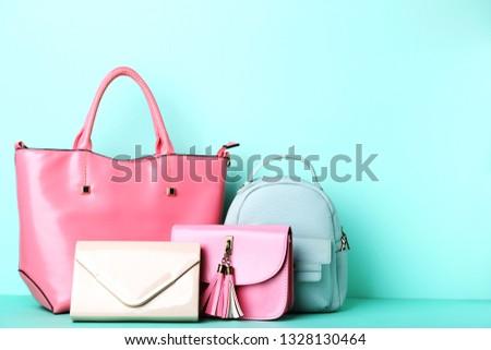 Fashion handbags on mint background