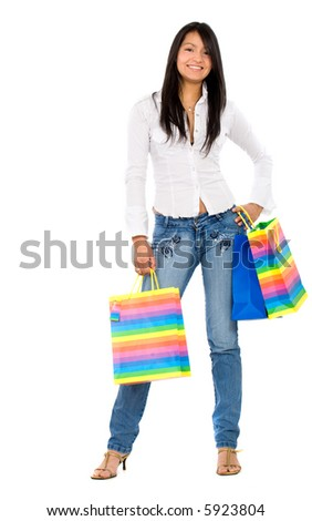 fashion happy girl smiling holding shopping bags - isolated over a white background