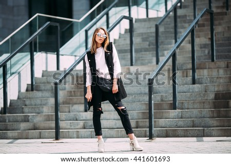 Fashion hipster cool girl in sunglasses. .urban background,fashion look #441601693