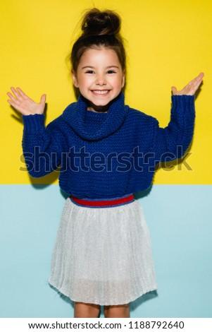 Fashion kid, kid model in a studio, bright background