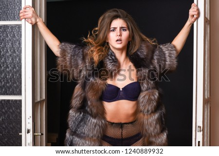 Fashion lady confident and seductive. Woman seductive appearance. Confident in her magnetism. Woman seductive wear luxury fur and lingerie. Seduction art concept. Female lover enter bedroom doors.