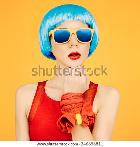 Fashion Lady in blue wig and sunglasses on bright yellow background