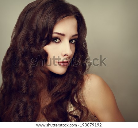 Fashion luxury female model with long curly hair. Vogue vintage portrait #193079192