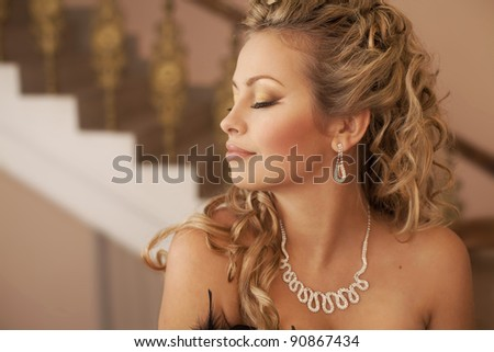 Fashion luxury retro portrait of beautiful thinking dreaming sexy young woman  with diamond necklace jewelery in the theater hall i classic Interior art girl blond hair closeup
