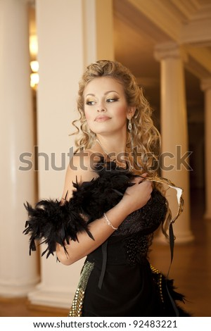 Fashion luxury retro portrait of beautiful young woman thinking dreaming sexy girl with golden venice party mask and diamond necklace jewelery in the theater hall classic Interior art closeup