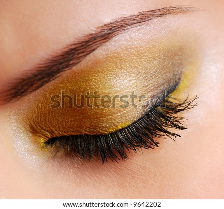 stock-photo-fashion-make-up-bright-yellow-eyeshadow-on-eyes-closed-9642202.jpg