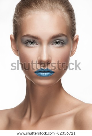 Fashion make-up with face art. Close-up portrait of beautiful young woman isolated on white background.
