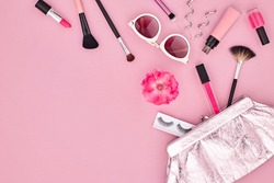 Fashion Makeup Cosmetic Set. Woman Beauty Accessories. Essentials. Design. Lipstick Brushes Eyeshadow, Glamor fashionable Stylish Clutch. Rose. Concept. Flat lay.
