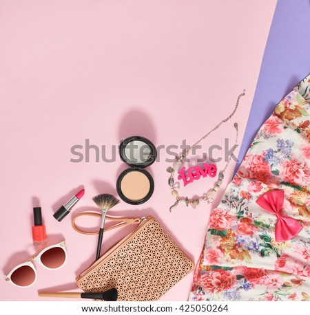 Fashion makeup,summer girl clothes,makeup accessories set. Woman makeup essentials.Cosmetics,makeup. Stylish handbag clutch, trendy dress, necklace, sunglasses.Unusual overhead makeup, outfit,top view