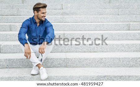 Fashion male model sitting and smiling #481959427