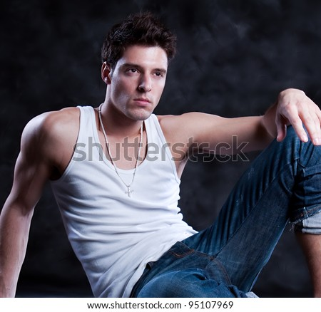 Fashion male portrait looking away deep in thought - isolated over a black background