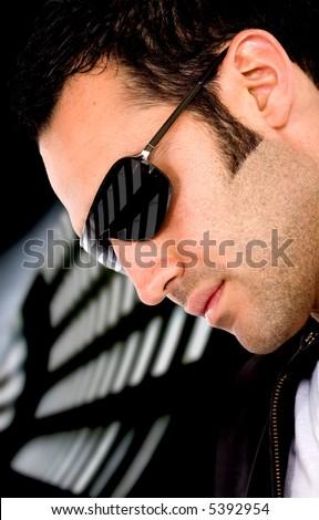 ♧♠ تــصويــت مســابقـــه روفــي فــاشــون ♧♠ stock-photo-fashion-male-portrait-wearing-sunglasses-isolated-over-a-dark-background-5392954.jpg
