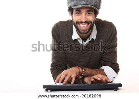 fashion man with a keyboard in front of the computer