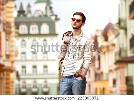 Fashion man with casual clothes walk in Europe