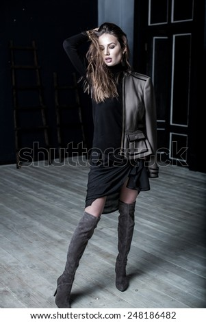 Fashion Military Style. Model in jacket, skirt and boots posing  #248186482