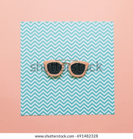 fashion minimal concept of pink sunglasses on geometric paper background. flat lay.  #691482328
