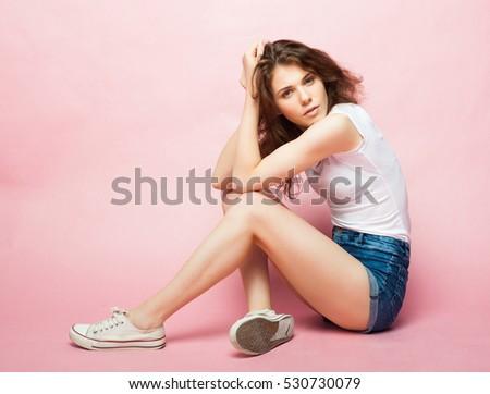 Fashion Model, Fashion, Teenage Girls. Posing over pink background.