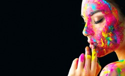 Fashion Model Girl colorful face paint. Beauty fashion art portrait, beautiful woman with painting smears, abstract makeup. Vivid paint make-up, bright colors. Multicolor creative make-up