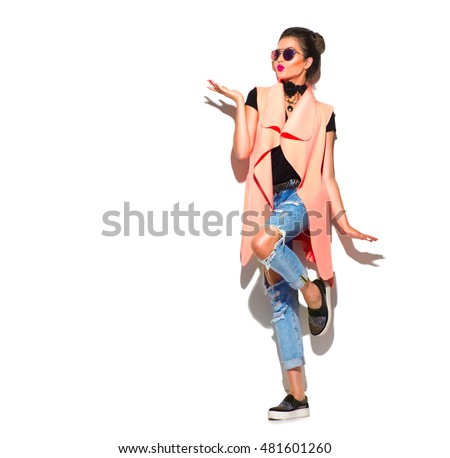 Fashion Model girl full length portrait isolated on white background. Beauty stylish woman proposing product, advertising gesture. Fashionable clothes in studio. Casual style High fashion urban style