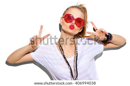 Fashion Model girl isolated over white background. Beauty stylish blonde woman posing in fashionable clothes and heart shaped sunglasses. Casual style with beauty accessories. High fashion urban style #406994038