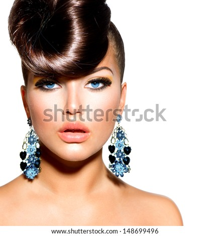 Fashion Model Girl Portrait with Blue Eyes and Earrings Creative Hairstyle Hairdo Make up Beauty Woman isolated on a White Background