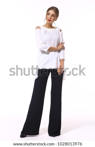 Stock Photo fashion model girl posing in designer flare trousers white shirt clothes high heels stiletto shoes full body length isolated on white