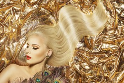Fashion Model Hairstyle and Beauty Makeup, Woman Waving Golden Color Hair Style and Beautiful Make Up, Gold Fabric Background