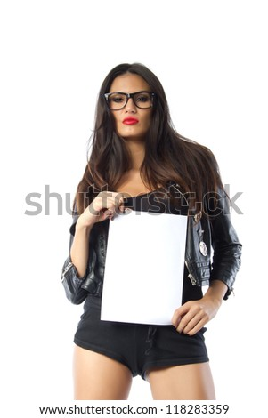 Fashion model holding a blank paper - Beautiful tall brunette model with a serious look on her face holding a vertically oriented blank sheet of paper, shot on white background