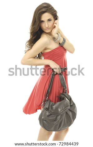Lifestyle - Pagina 5 Stock-photo-fashion-model-holding-bag-posing-in-isolated-studio-72984439