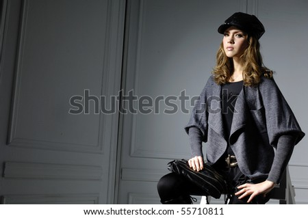 fashion model in autumn/winter clothes posing