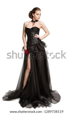 814dc32ee Fashion Model in Black Corset Dress holding Red Rose Flower