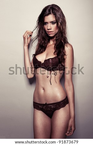 Fashion Model In Black Lingerie, young attractive brunette modeling lingerie