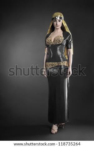 Fashion model in elegant dress. Woman in oriental dancer costume - stock photo