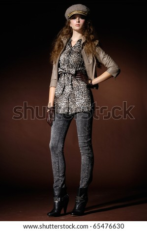 fashion model in fashion clothes posing in the studio - stock photo
