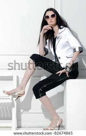 fashion model in fashion dress sitting cube posing in the studio