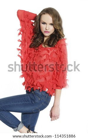 Fashion model in red jeans standing posing